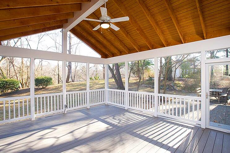 screened-in porch in maryland with wood ceiling and white ceiling fan