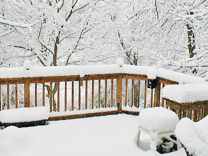 snow-covered deck with a wintry disposition