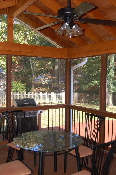 natural stained wood porch and screened room MD interior