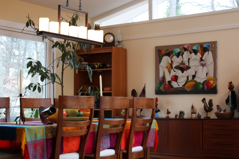 new dining room expansion with stained wood furniture and a colorful tabletop display