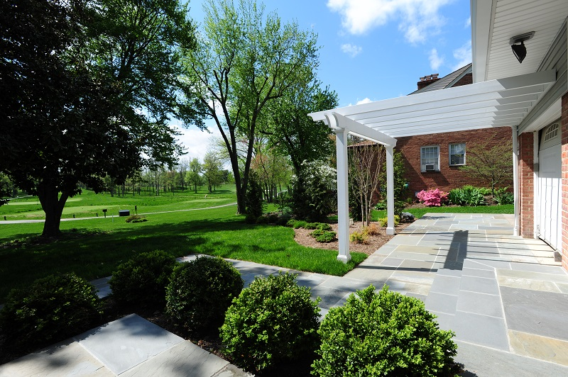 elevated flagstone patio with white trim in Rockville, Maryland