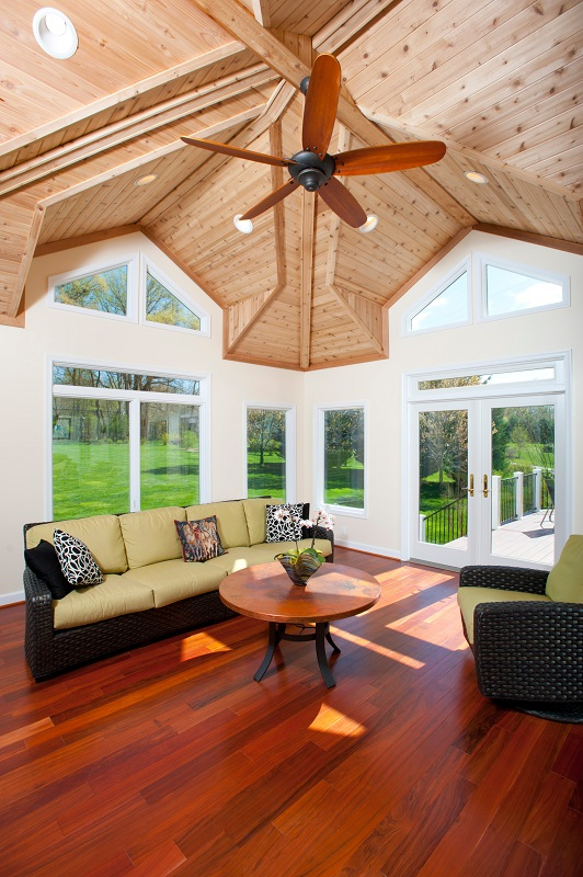 sunroom interior Bowie, Maryland by Design Builders. Brazilian hardwood floor