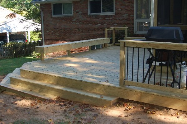 unstained pressure-treated screened room and deck in Bethesda