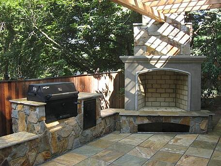 outdoor brick fireplace and stone outdoor kitchen in maryland