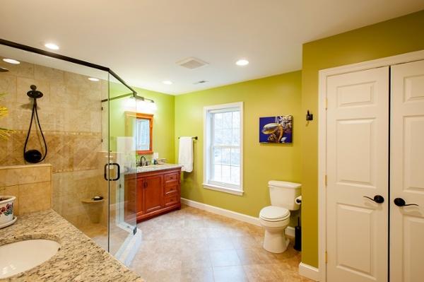 designer master bathroom in green divided sinks custom shower Fairfax VA