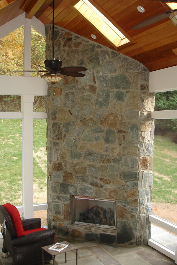 paver patio screen room fireplace indoors Potomac, Maryland