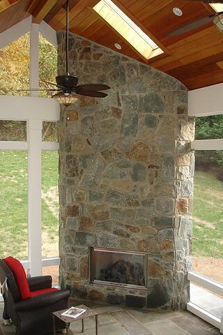 outdoor ground-level fireplace in screened porch, Potomac, Maryland