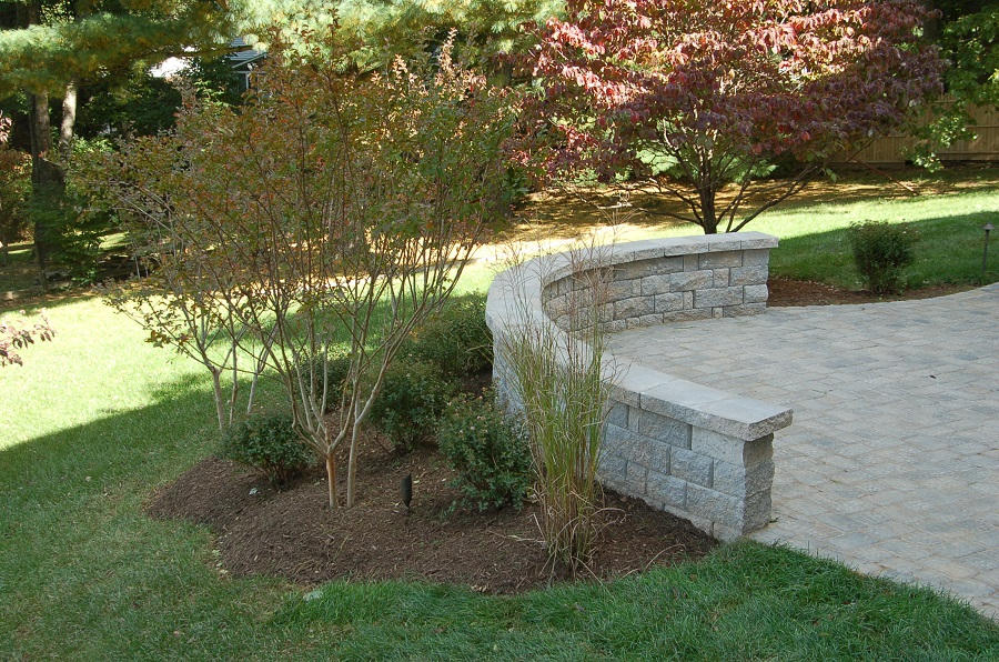 curved sitting wall builder in Potomac, MD with paver patio far shot