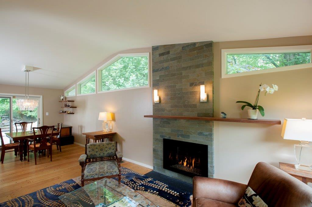 stone fireplace living room and dining interior remodeling project in Bethesda, Maryland