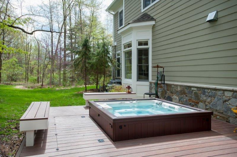 recessed hot tub low-maintenance wold deck with built-in benches during daytime in bethesda, maryland