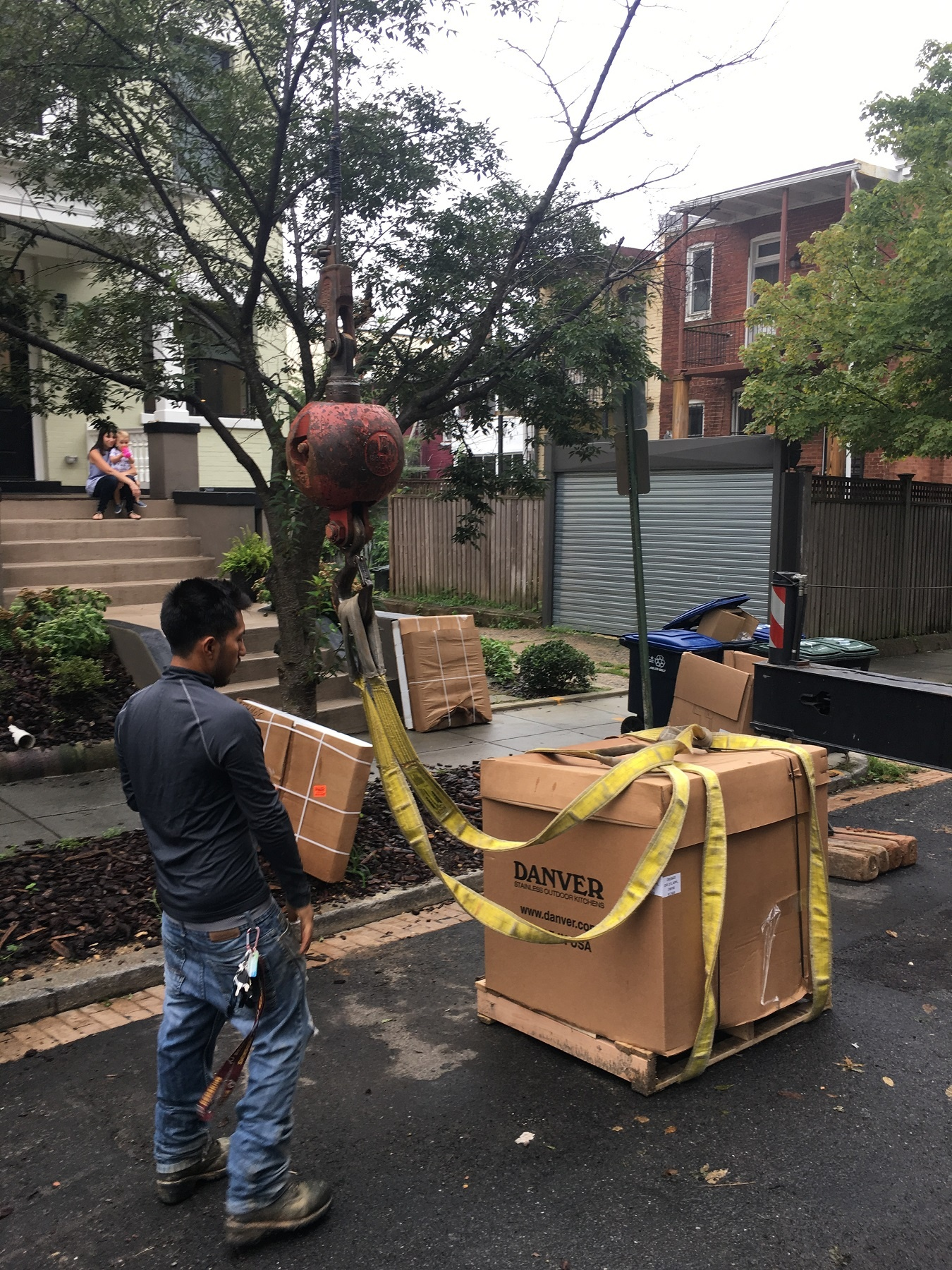 loading a crane with danver cabinets for a rooftop deck delivery in Washington, DC
