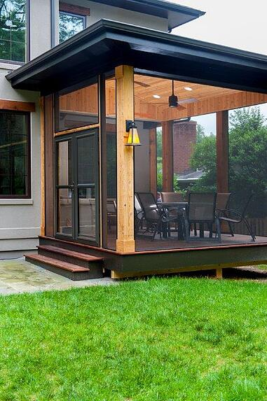 hardwood screened-in porch of contemporary design with black trim