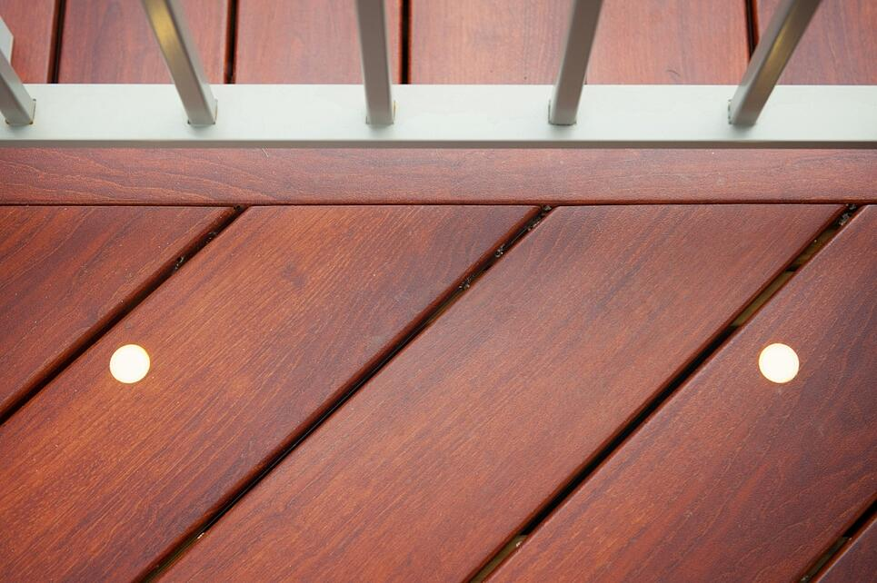 up close of brazilia zuri deck boards with inset deck lighting