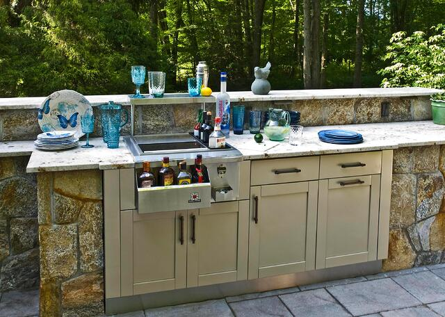 champagne Danver cabinets with bar area