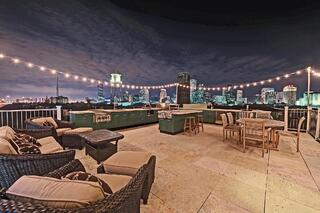 creative rooftop deck with powder coated Danver cabinets in New Orleans, LA at night