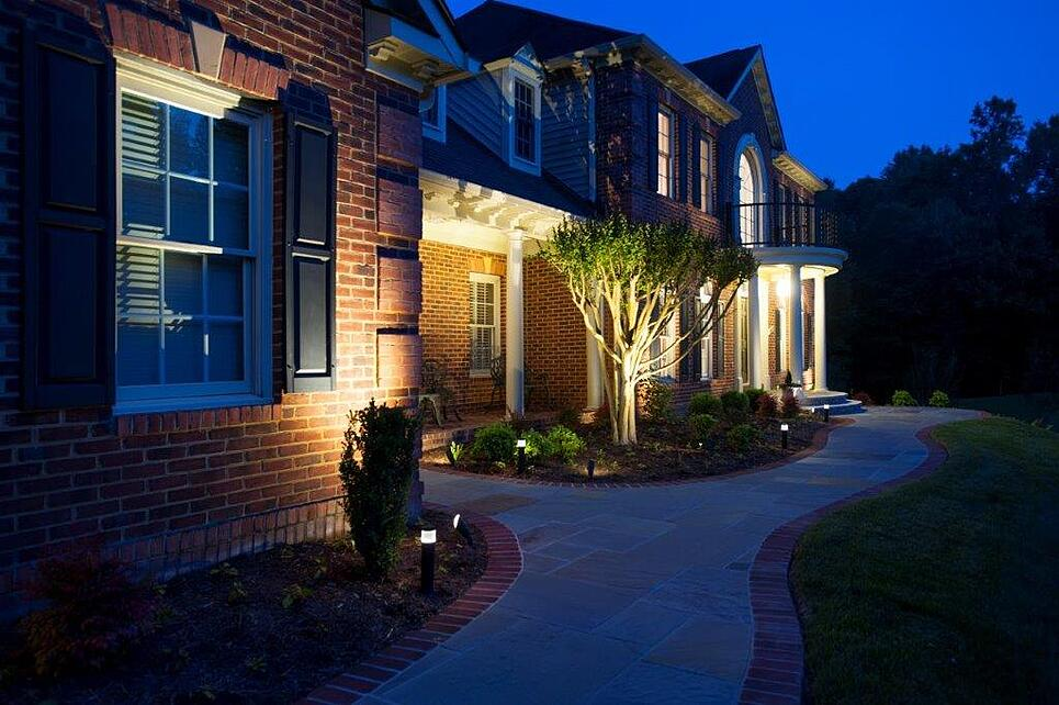 custom front walkway with flagstone and brick pavers at night with outdoor lighting package (1).jpg