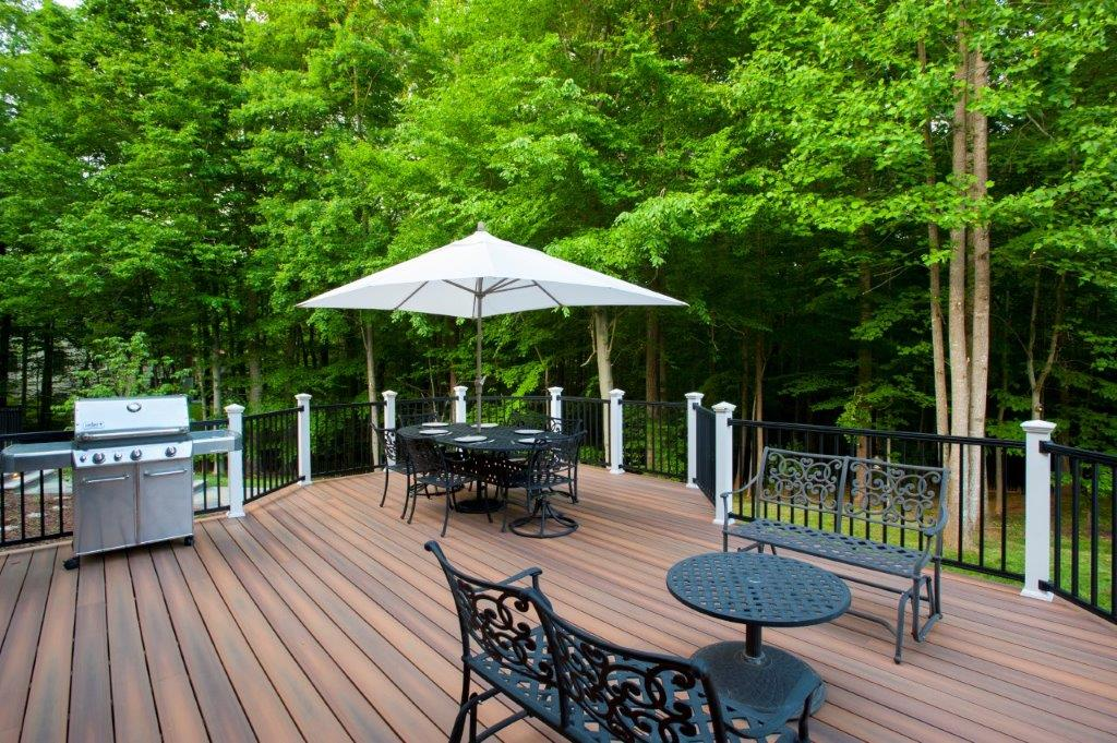 fiberon deck in virginia with black deckorators balusters, iron patio furniture and a stainless steel grill