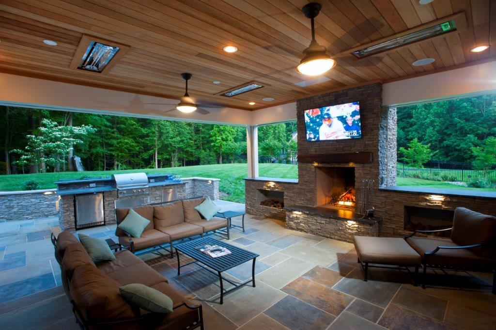 burning stone fireplace in a screened porch backyard clifton virginia
