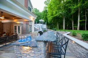 Eldorado_stone_outdoor_kitchen_with_Blaze_grill_trash_pull_outdoor_fridge_and_stainless_steel_outdoor_kitchen_cabinet_inserts_2