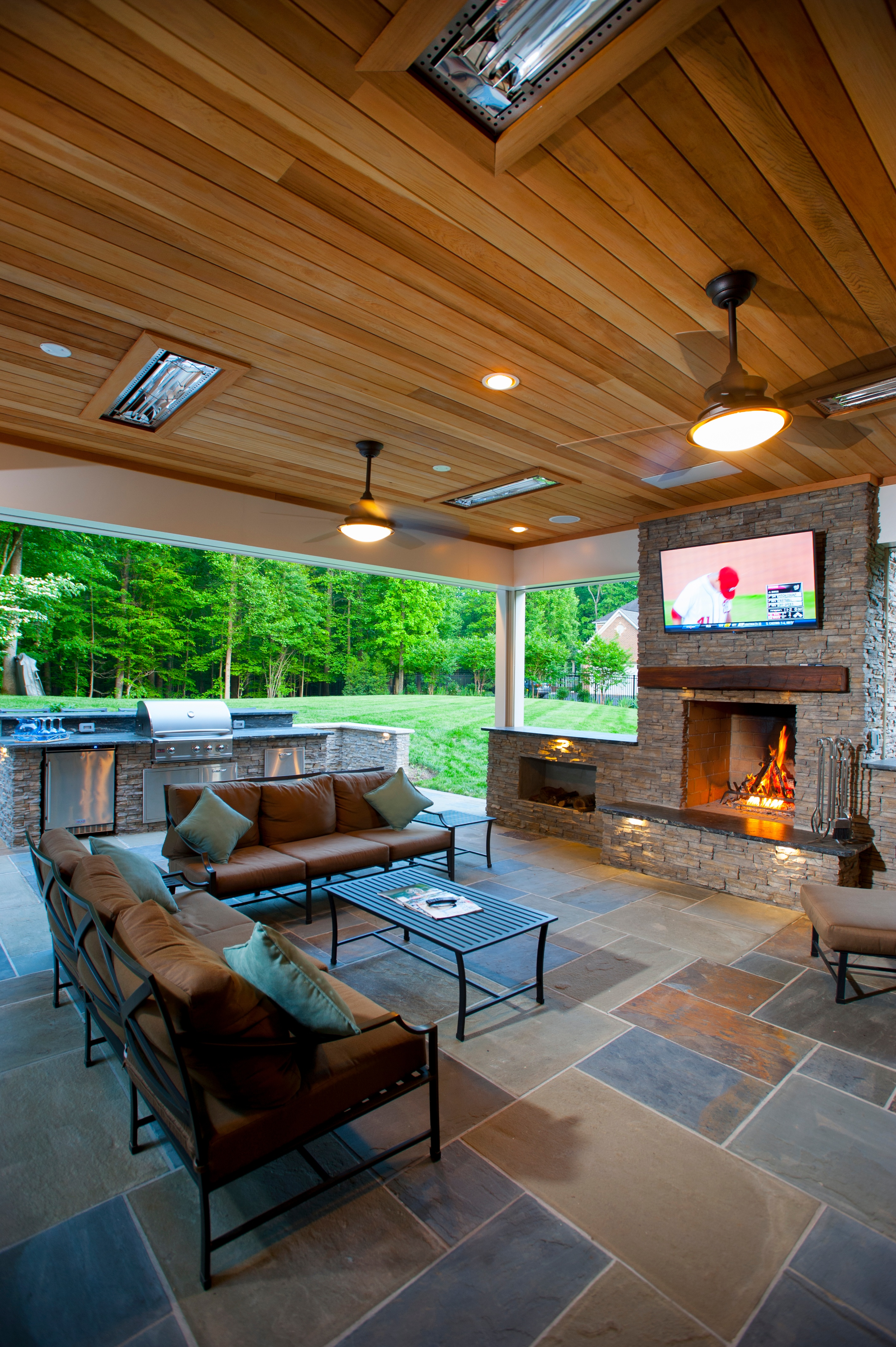Infratech infrared heaters shown in a covered flagstone patio with Phantom retractable screens in Clifton, Virginia