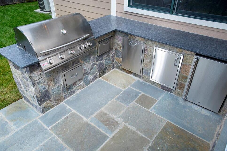 outdoor flagstone kitchen with stainless steel appliances