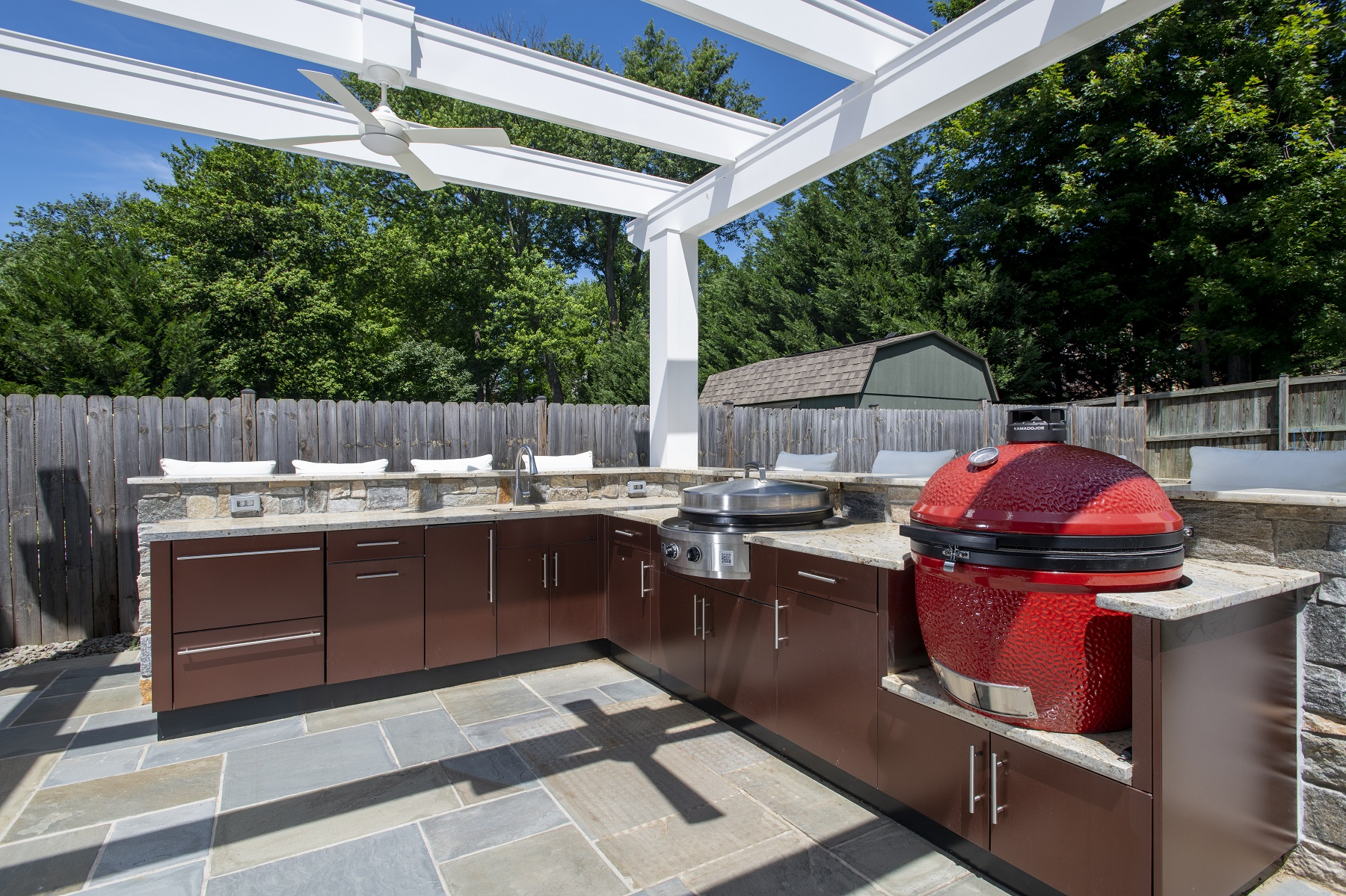 danver outdoor kitchen with white pergola and flagstone patio in bethesda