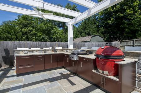 Danver outdoor kitchen design in red with a Green Egg smoker