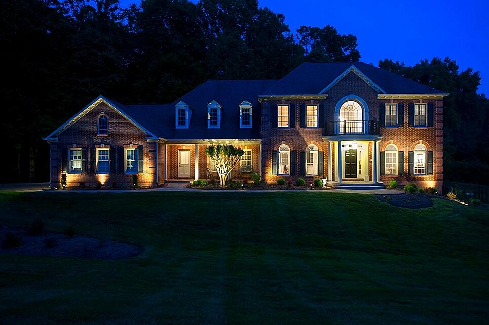 home additions contractor results at dusk with outdoor lighting in clifton, virginia