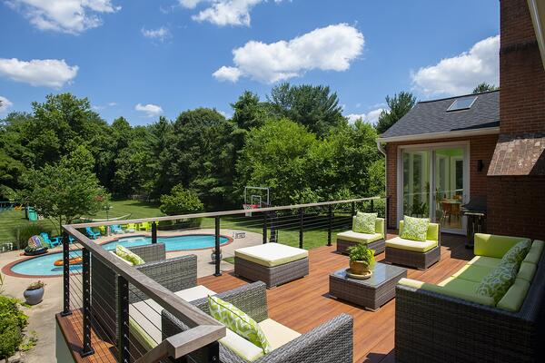 luxury pool deck with cable handrails, performance deck boards, and brown jordan furniture in bethesda, maryland