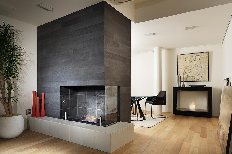 EcoSmart Fire indoor fireplace with black tile, wood floor, and white walls