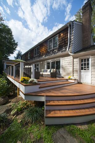 Zuri deck in Potomac, Maryland with a curved staircase and beautiful decking