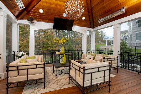 luxurious screened porch with low-maintenance zuri decking and high-end design in bowie, maryland