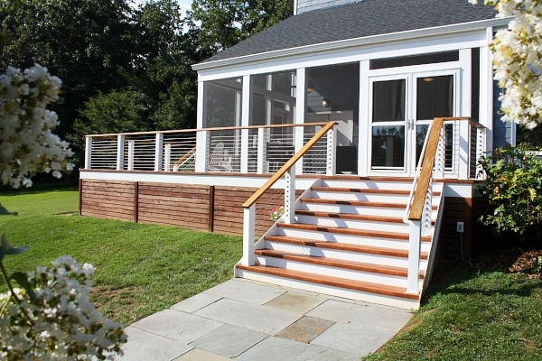 Zuri deck and screen room with white trimmed stainless steel handrails in montgomery county