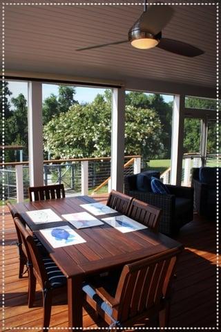 screened_porch_interior_with_zuri_decking_pecan-minka_aira_ceiling_fans-white_trim_6-906935-edited.jpg