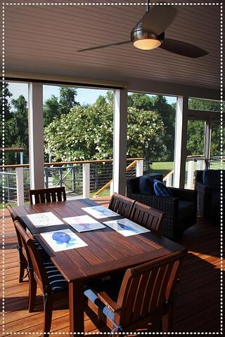 screened_porch_interior_with_zuri_decking_pecan-minka_aira_ceiling_fans-white_trim_6-906935-edited.jpg