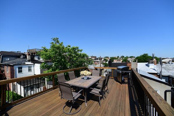 hardwood rooftop deck design 5 years after being built in Maryland