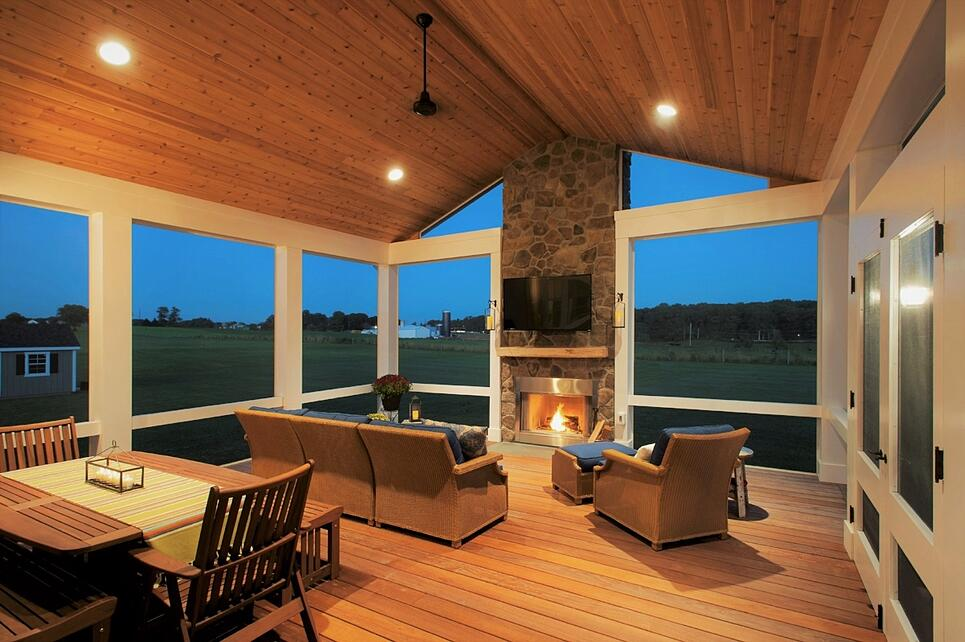 Wood Screen Porch With Stone Fireplace Interior View