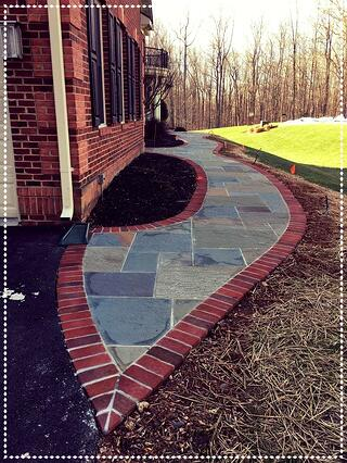 concrete paver patio with brick paver border during construction phase in Clifton, Virginia