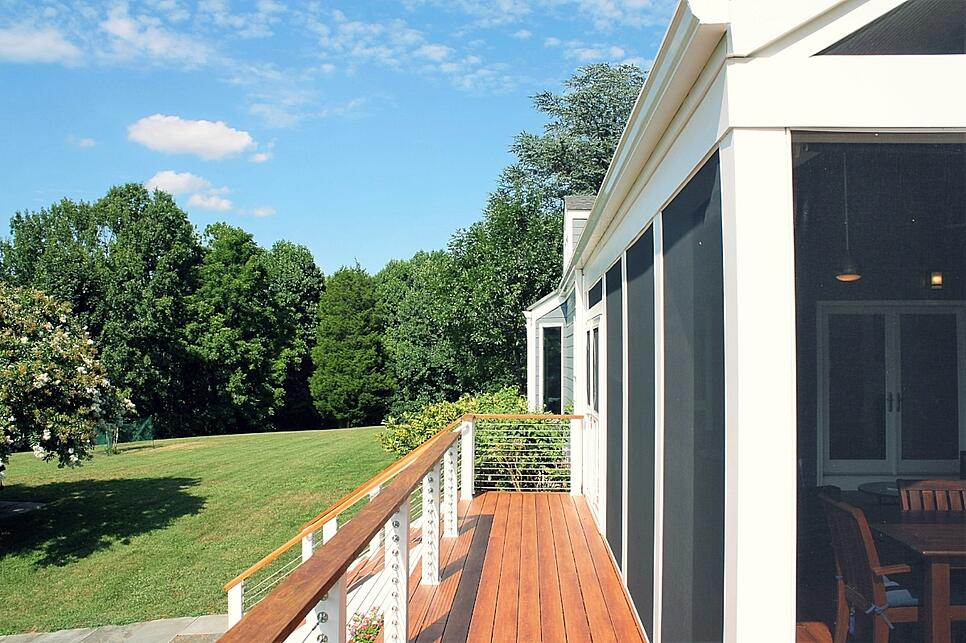 white-pvc-trimmed-screened-porch-in-maryland-steel-cable-handrails-screeneze.jpg