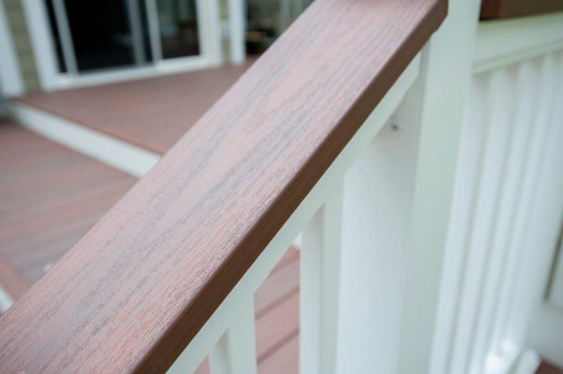 Wolf PVC decking handrail in rosewood trim