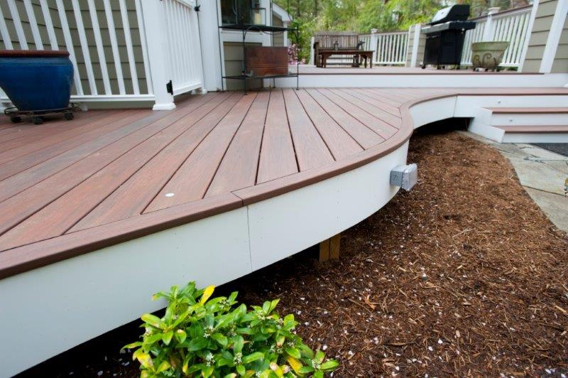 curved low-maintenance deck made with Wolf rosewood deck boards