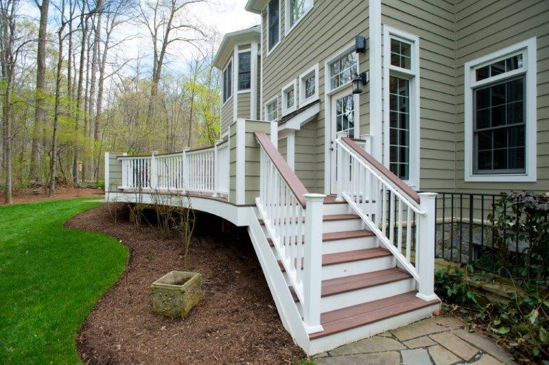 low-maintenance Wolf decking staircase, rosewood trim
