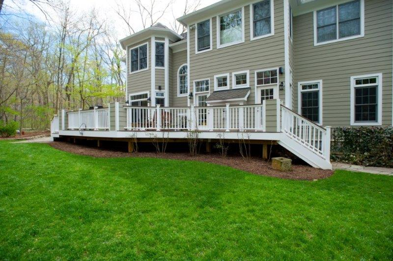 wide shot of deck in Maryland with white PVC trim and Wolf rosewood decking