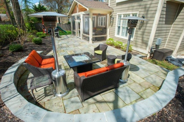 custom curved sitting wall and flagstone patio