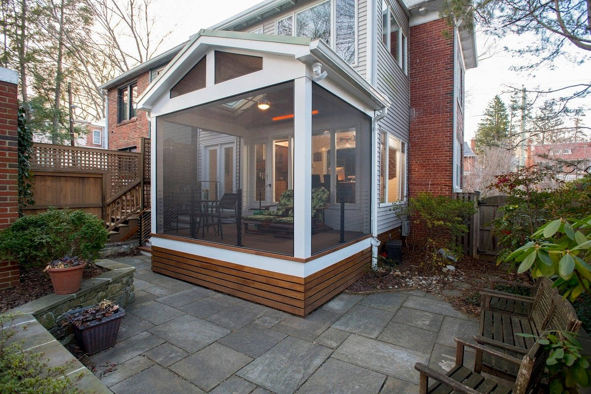 pressure-treated screened porch with white pvc trim and large screeneze screening systems